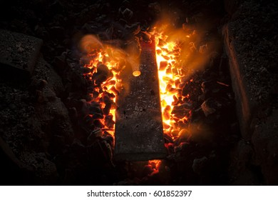 Furnace with charcoal and iron bar