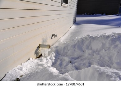 A furnace exhaust vent dug out in January to keep the furnace from shutting down during cold winter days in Wisconsin.