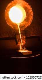 Furnace melting gold at very high temperatures for the production of gold ingots, showing intense colors, very hot molten gold, metallurgical industry.