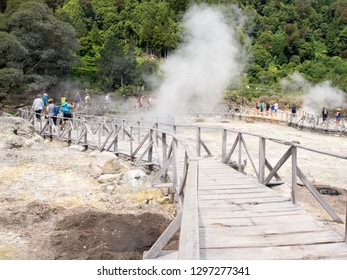 Furnas, Azores Islands - August 19, 2018: Tourists watching the steam from volcanic calderas at Furnas Lake, Sao Miguel, Azores, Portugal