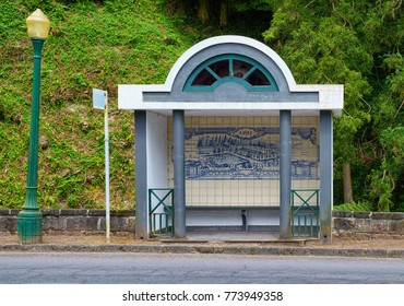 FURNAS, AZORES, PORTUGAL - JUNE 27, 2017: Bus stop with typical decor made of painted ceramic tiles called azulejo in Portuguese, located in Furnas town on Azorean island of Sao Miguel, Portugal.