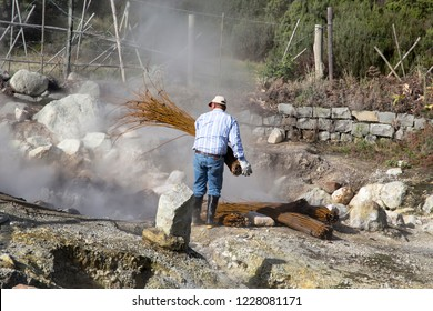 FURNAS SAO MIGUEL ISLAND AZORES PORTUGAL ON JANUARY 2018: Man working with wicker at Steaming caldera at Furnas Lake Sao Miguel island Azores Portugal