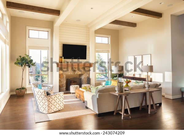 Furnished living Room Interior with Hardwood Floors and Intricately Designed Ceiling in Beautiful New Luxury Home