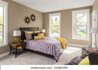 Furnished master bedroom interior in new home with colorful furnishings