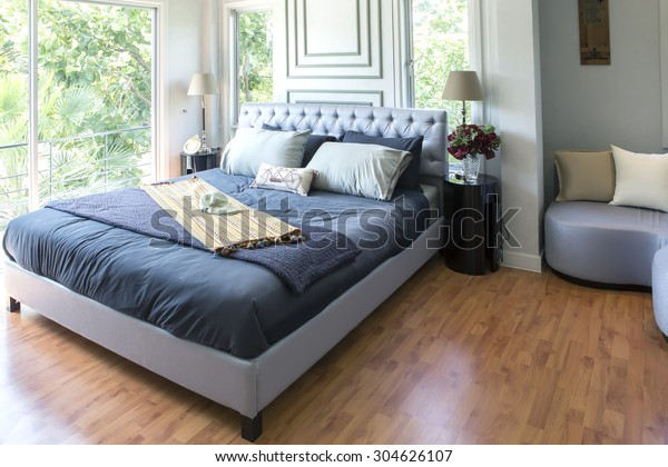 Furnished master bedroom in new luxury home.