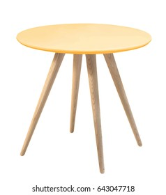 Furniture from 50 to 60 years of the last century. Orange round table with wooden legs on white background