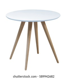 Furniture from 50-60 years of the last century.Light blue round table with wooden legs on a white background