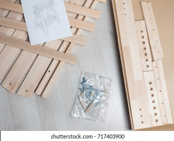 Furniture Assembly Parts And Tools For Self Assembly Furniture, On The  Floor. Instructions For