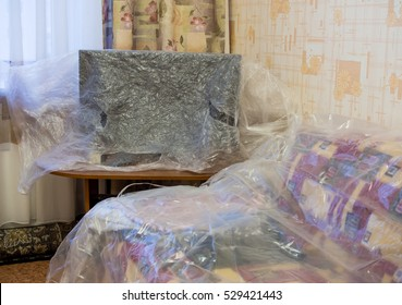 Furniture, covered with plastic film on the repair time