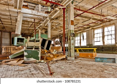 Furniture falling through a hole in the floor above. Abandoned factory.