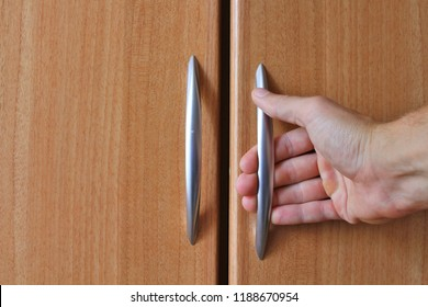 Furniture handle in hand