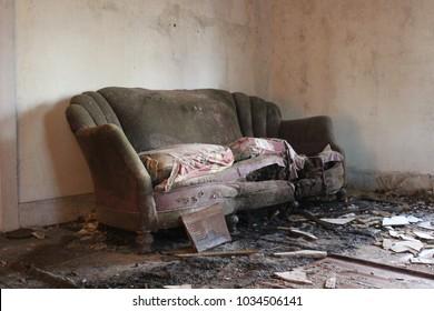 Furniture left behind after eviction inside of abandoned farm house