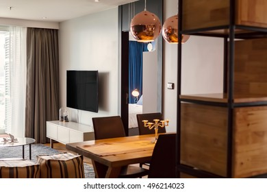 Furniture in living room interior design, lamps, TV screen on the wall, big window, wooden table and shelves