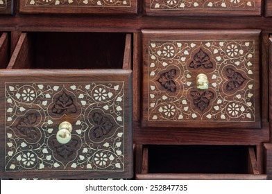 Furniture made of rosewood inlaid and carved out of India .