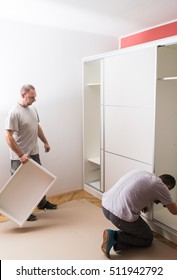 Furniture maker sets wardrobe in bedroom