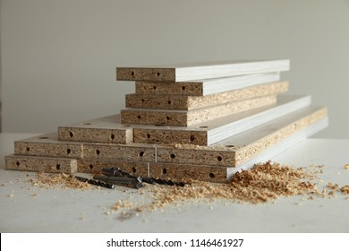 furniture manufacturing / details MDF, drills, confirmation, sawdust