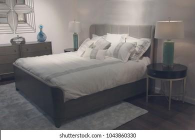 Furniture is modern bedroom in beige tones. Interior