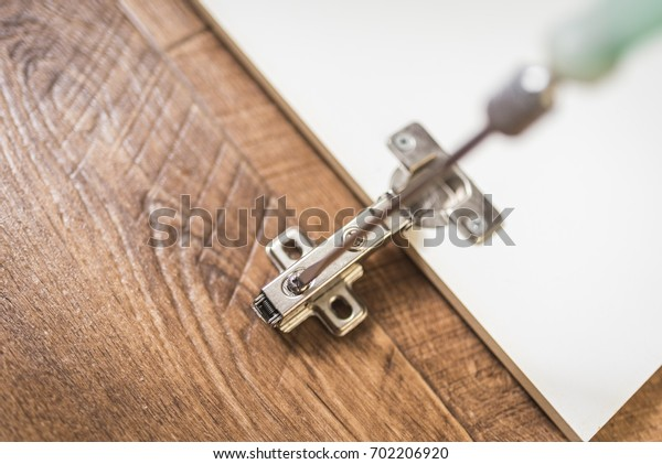 Furniture repair, cabinet door hinges
