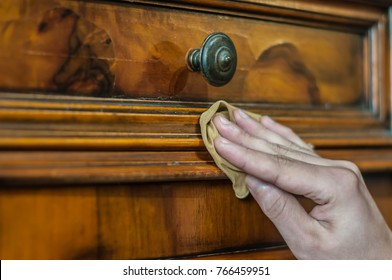 Furniture restoration. Hand cleaning a wood furniture with a cloth