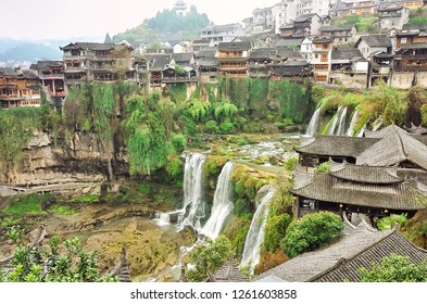 Furong Ancient Town, Hibiscus Town with the great waterfall and Tujia Diaojiaolou (stilted house) in Xiangxi Hunan, China.