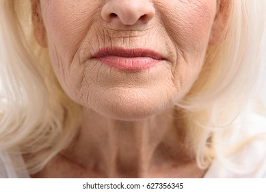 Furrowed lips of mature woman