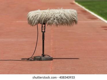 Furry sport microphone on a soccer field
