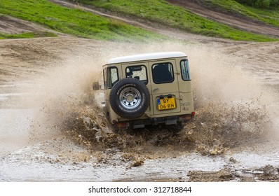 FURSTENAU, GERMANY - MAY 09, 2015: A Toyota 4-wheel drive is driving through a pond of water on a special off the road terrain for land cruisers and vehicles in Germany