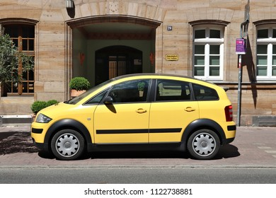 FURTH, GERMANY - MAY 6, 2018: Yellow Audi A2 compact mini car parked in Germany. There were 45.8 million cars registered in Germany (as of 2017).