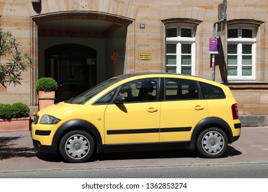 FURTH, GERMANY - MAY 6, 2018: Yellow Audi A2 compact mini car parked in Germany. The car was designed by Belgian car designer Luc Donckerwolke.