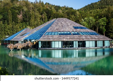 Fuschl am See, Austria - June 24, 2019: Red Bull Headquarters in Fuschl am See with a beautiful surounding and the characteristic bronze sculpture in front