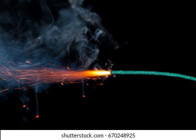 Fuse burning on black background isolated
