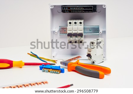 fusebox with four automatic fuses during installation  electricity  distribution box  electrical cabinet with tools
