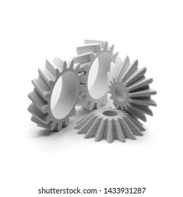 Fused Deposition Modelling (FDM) 3D printed helical and bevel gears printed in white PLA on a white backdrop