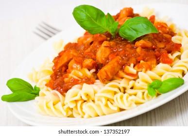 Fusilli pasta with chicken breast in tomato sauce