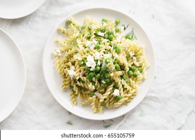 Fusilli pasta with green peas and herbs
