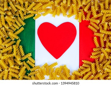 Fusilli pasta on Italian tricolore flag background - for love & passion of cuisine, cooking and recipes from Italy.