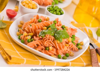 Fusilli pasta with peas and sweet corn.