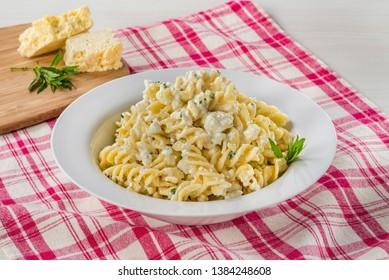 Fusilli pasta plate Creamy Italian pasta with cheese and cream