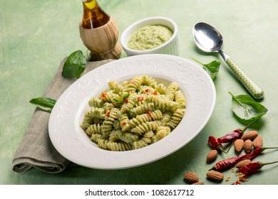 fusilli with pesto sauce and hot chili pepper