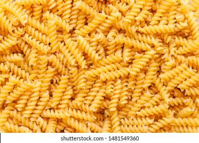 Fusilli spaghetti pattern background. Fusilli background.