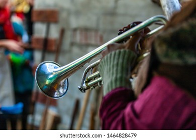 Fusion of cultural & modern music event. A trombone is seen close up, in the hands of a blurred musician, playing at a live music festival fusing traditional and native sounds , with copy space