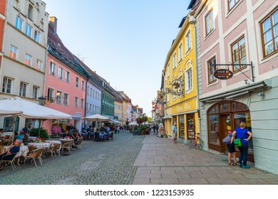 FUSSEN, GERMANY - AUG 28, 2018: Street cafe in the Fussen old town city centre. Fussen is a small town in Bavaria, Germany.