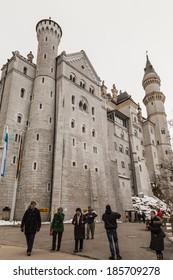 FUSSEN, GERMANY - DECEMBER 18, 2013: Visitors leaving Neuschwanstein Castle
