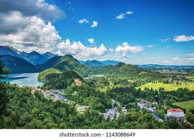 Fussen, Germany- June 10, 2018: Lake Alpsee and Hohenschwangau Castle. View of Schloss Hohenschwangau, ancestral home to Bavaria's King Ludwig II, builder of some of Germany's most famous castles.
