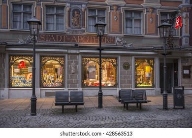 FUSSEN, GERMANY - MARCH 11, 2016: Showcase of an old pharmacy in the pedestrian center of the city Fussen in Bavaria , Germany