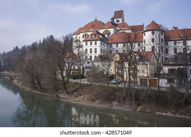 FUSSEN, GERMANY - MARCH 11, 2016: View of Lech river and Monastery of St. Mang River in Fussen