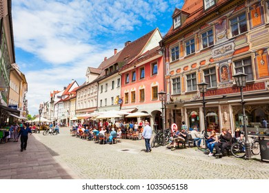 FUSSEN, GERMANY - MAY 23, 2017: Street cafe in the Fussen old town city centre. Fussen is a small town in Bavaria, Germany