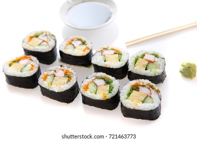 Futomaki sushi , Japanese roll rice egg avocado cucumber and caviar isolated in white background
