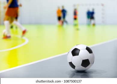 Futsal Background. Indoor Soccer Futsal Ball. Indoor Soccer Match in the Background. Futsal Sports Hall and Futsal Field. Youth Indoor Soccer League.