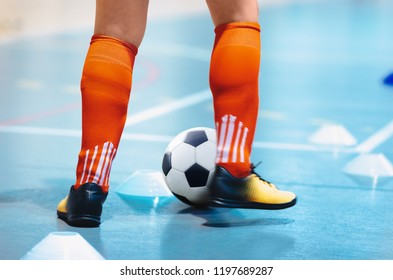 6e834a1a5 Futsal league. Indoor soccer player in futsal shoes training dribble drill  with ball. Indoor